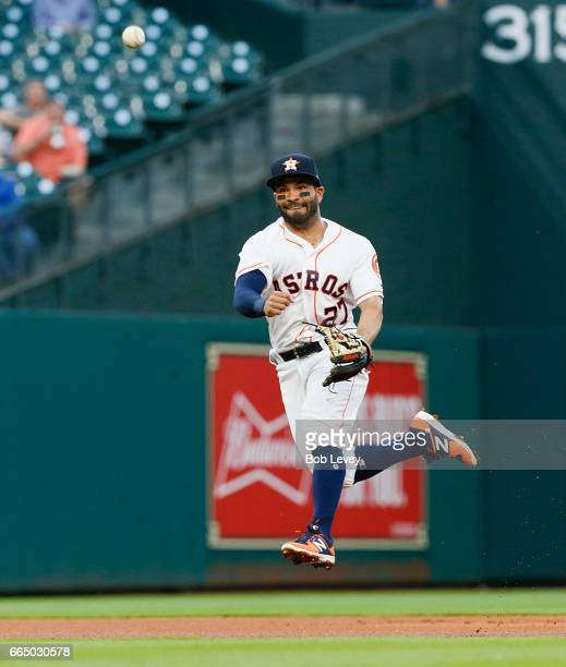 Jose Altuve of the Houston Astros throws out Nelson Cruz of the Seattle Mariners in the first inning at Minute Maid Park on April 5 2017 in Houston...