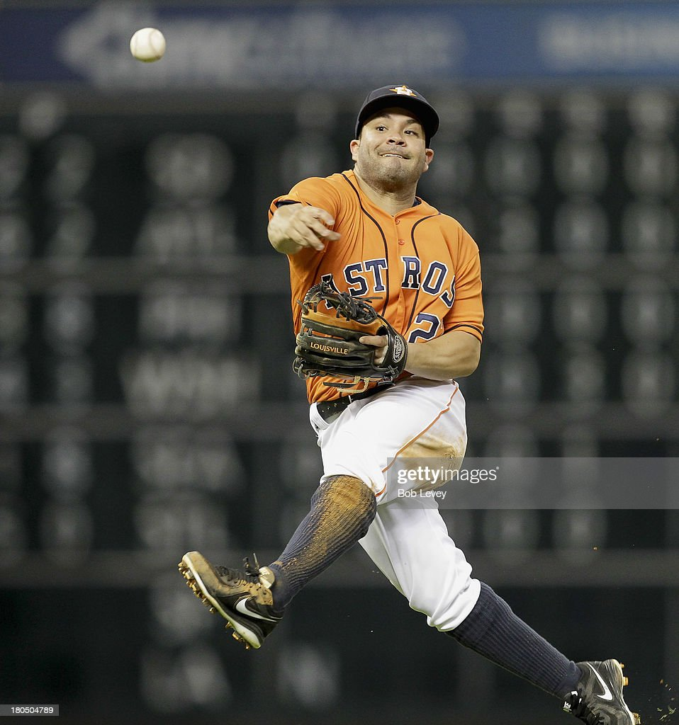 <a gi-track='captionPersonalityLinkClicked' href=/galleries/search?phrase=Jose+Altuve&family=editorial&specificpeople=7934195 ng-click='$event.stopPropagation()'>Jose Altuve</a> #27 of the Houston Astros throws to first base after making a play on a slow-hit ground ball off the bat of Andrew Romine (not pictured) of the Los Angeles Angels of Anaheim in the sixth inning at Minute Maid Park on September 13, 2013 in Houston, Texas.