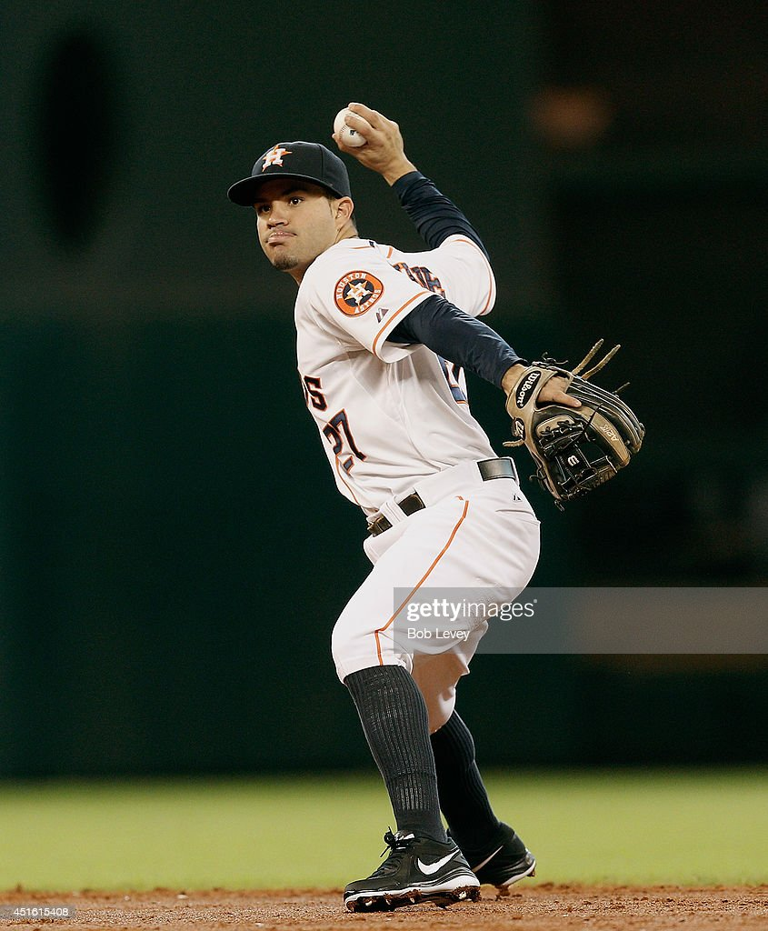 Jose Altuve #27 of the Houston Astros throws to first base against the Seattle Mariners at Minute Maid Park on July 2, 2014 in Houston, Texas.