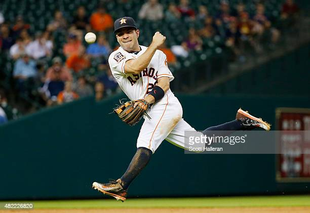 Jose Altuve of the Houston Astros throws to first base in the eighth inning of their game against the Los Angeles Angels of Anaheim at Minute Maid...