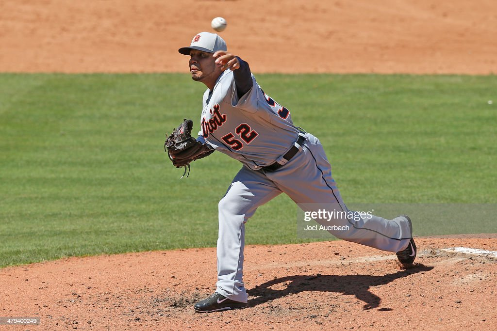 Jose Alvarez #52 of the Detroit Tigers throws the ball against the New York Mets during in the fourth inning of a spring training game at Tradition Field on March 18, 2014 in Port St. Lucie, Florida.