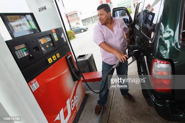 Jose Alvarez pumps gas at the Ugas station March 6 2011 in Miami Florida The national average for a gallon of selfserve regular gas was $350 a 33...