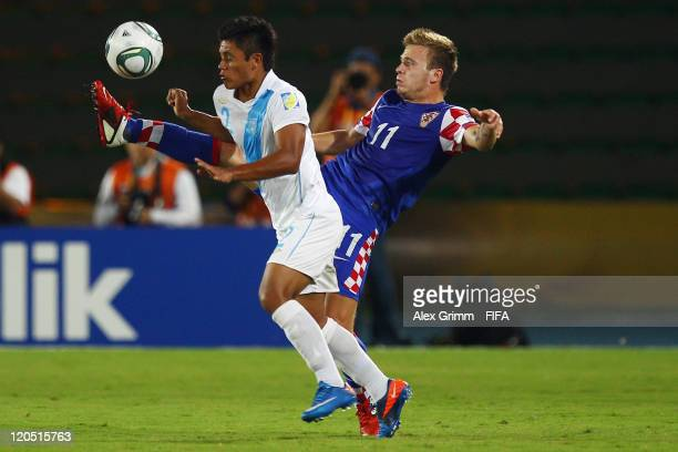 Jose Andrade of Guatemala is challenged by Mario Ticinovic of Croatia during the FIFA U20 World Cup 2011 Group D match between Croatia and Guatemala...