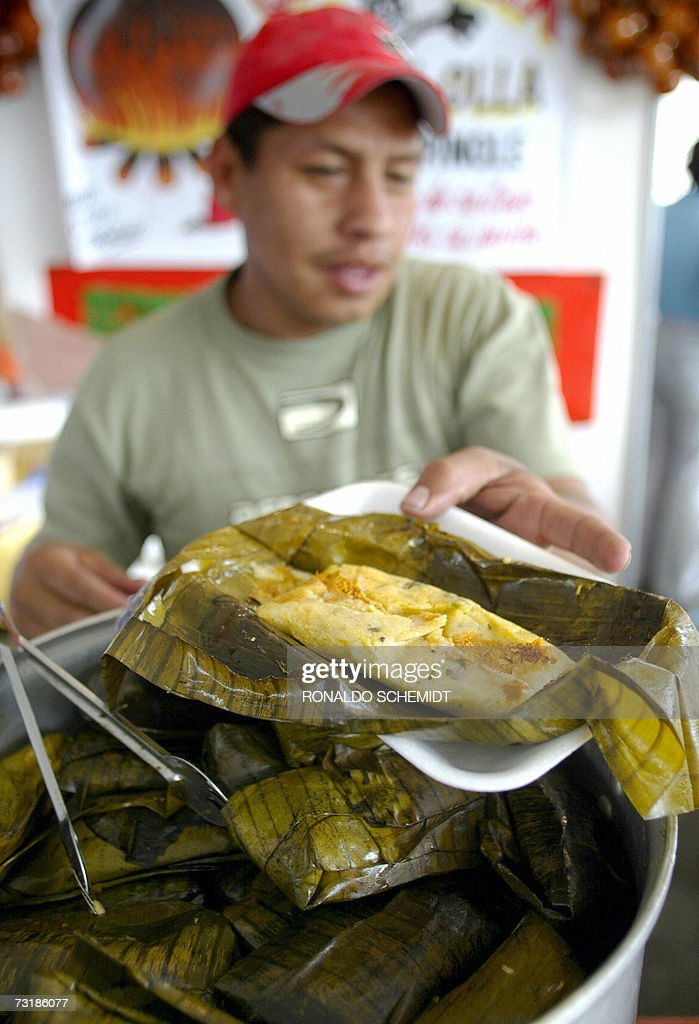 Jose Angel Arias of the Mexican state of Tabasco serves a tamale of fish and maize on February 2nd 2007 at the Tamale Latin American fair held in...