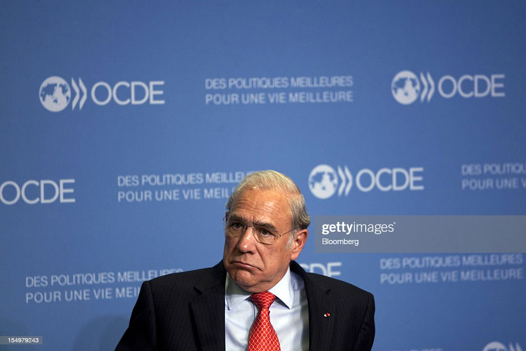 Jose Angel Gurria, secretary general of the Organization for Economic Cooperation and Development (OECD), sits and listens during a news conference following a meeting hosted by the OECD in Paris, France, on Monday, Oct. 29, 2012. French President Francois Hollande said he wants the euro group of finance ministers to find a 'durable' solution to Greece's debt problems at their November meeting. Photographer: Balint Porneczi/Bloomberg via Getty Images
