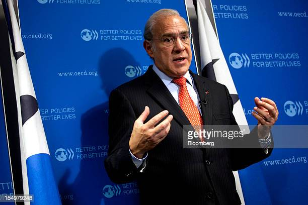 Jose Angel Gurria secretary general of the Organization for Economic Cooperation and Development gestures as he speaks during a news conference...