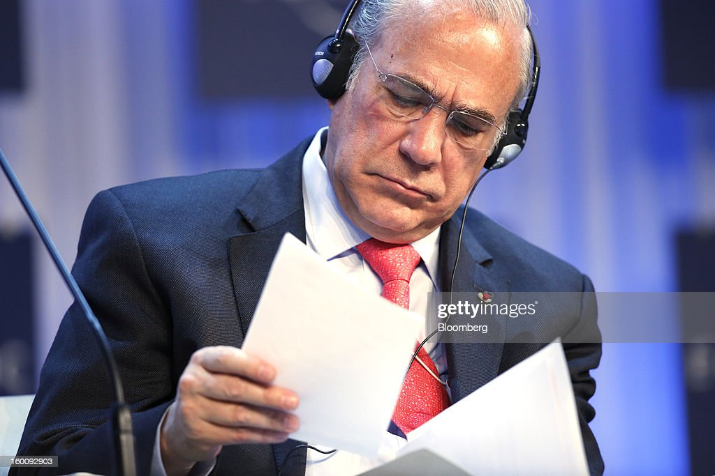 Jose Angel Gurria, secretary-general of the Organization for Economic Cooperation and Development (OECD), looks at paperwork during a session on the final day of the World Economic Forum (WEF) in Davos, Switzerland, on Saturday, Jan. 26, 2013. World leaders, influential executives, bankers and policy makers attend the 43rd annual meeting of the World Economic Forum in Davos, the five day event runs from Jan. 23-27. Photographer: Jason Alden/Bloomberg via Getty Images