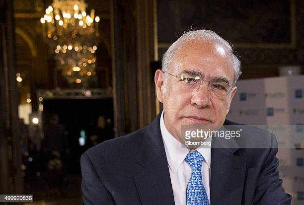 Jose Angel Gurria secretarygeneral of the Organization for Economic Cooperation and Development poses for a photograph before a Bloomberg Television...