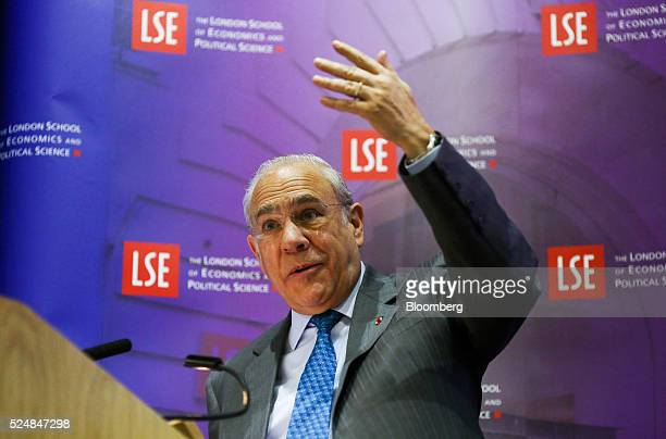 Jose Angel Gurria secretarygeneral of the Organization for Economic Cooperation and Development gestures whilst delivering a speech at the London...