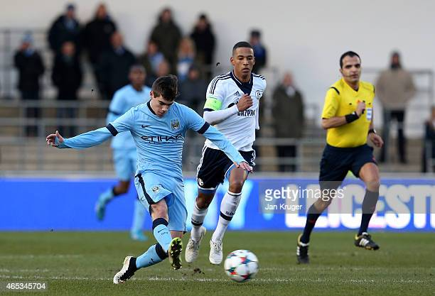 Jose Angel Pozo of Manchester City FC clears the ball from Thilo Kehrer of FC Schalke 04 during the UEFA Youth League Round of 16 match between...