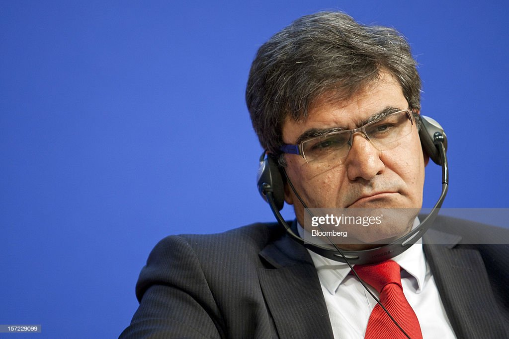Jose Antonio Alvarez, chief financial officer of Banco Santander SA, listens via headphones to speakers during a financial conference at the Ministry of Economy, Finance and Industry in Paris, France, on Friday, Nov. 30, 2012. The European Central Bank will do 'whatever is necessary to save euro' and is ready to intervene when needed, ECB President Mario Draghi said, while saying 'there will always be conditions' to intervention. Photographer: Balint Porneczi/Bloomberg via Getty Images