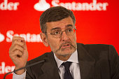 Jose Antonio Garcia Canter chief financial officer of Banco Santander SA gestures whilst speaking during a news conference at the bank's headquarters...