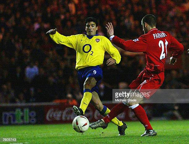 Jose Antonio Reyes of Arsenal scores an own goal under pressure from Stuart Parnaby of Middlesbrough during the Carling Cup semi final second leg...