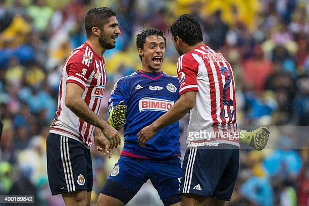 Jose Antonio Rodriguez goalkeeper of Chivas celebrates with teammates Jair Pereira and Oswaldo Alanis after defeating America in a 10th round match...