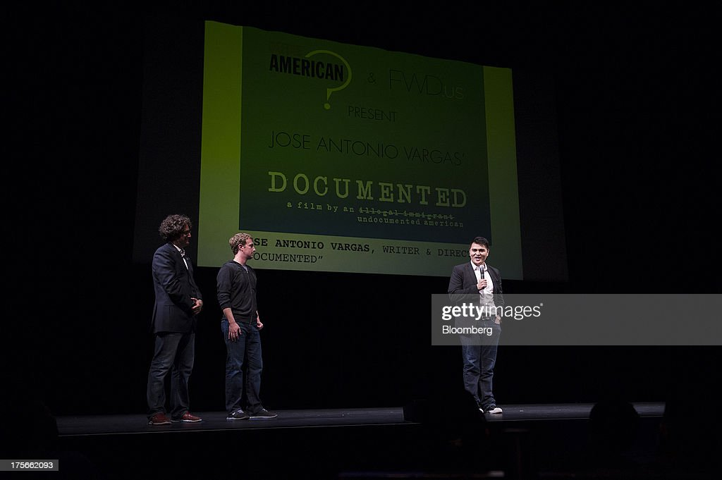 Jose Antonio Vargas, filmmaker and journalist, right, speaks as Mark Zuckerberg, chief executive officer of Facebook Inc., center, and Joe Green, president and co-founder of FWD.us, look on prior to a screening of 'Documented' in San Francisco, California, U.S., on Monday, Aug. 5, 2013. 'Documented' is a film written and directed by Vargas, an undocumented immigrant. Photographer: David Paul Morris/Bloomberg via Getty Images