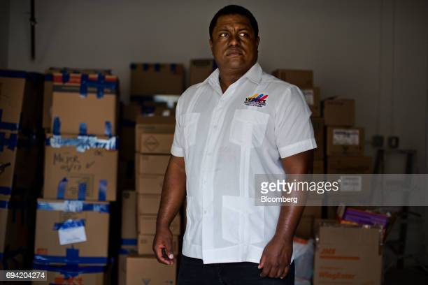 Jose AntonioColina head of Politically Persecuted Venezuelans in Exile stands for a photograph in front of boxes of supplies to be shipped to...