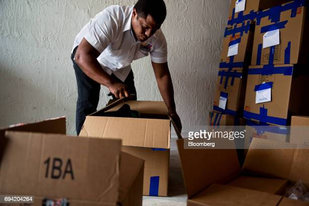 Jose AntonioColina head of Politically Persecuted Venezuelans in Exile packages supplies to be shipped to Venezuelan protesters from Miami Florida...