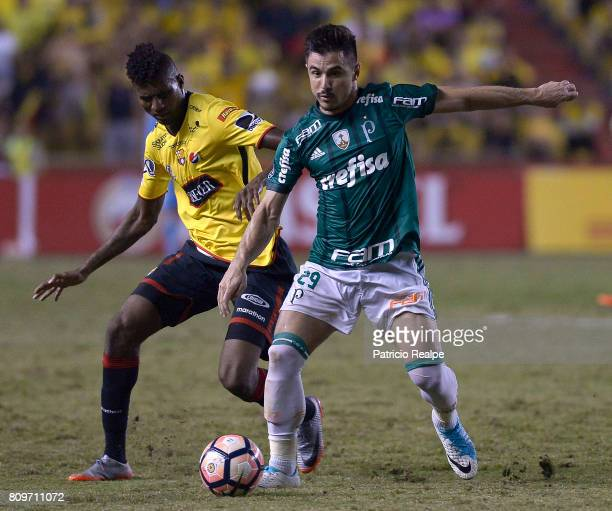 Jose Ayovi of Barcelona fights for the ball with Willian of Palmeiras during a first leg match between Barcelona SC and Palmeiras as part of round of...
