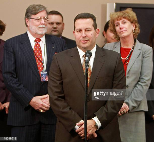 Jose Baez lead defense counsel for Casey Anthony answers questions as cocounsel Cheney Mason Dorothy Clay Sims looks on after his client was found...