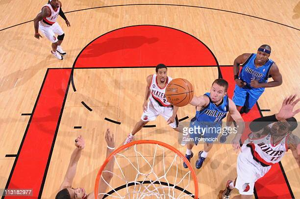 Jose Barea of the Dallas Mavericks shoots against LaMarcus Aldridge and Nicolas Batum of the Portland Trail Blazers in Game Four of the Western...