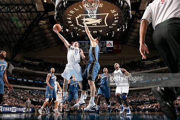 Jose Barea of the Dallas Mavericks shoots against Yi Jianlian of the Washington Wizards on January 31 2011 at the American Airlines Center in Dallas...