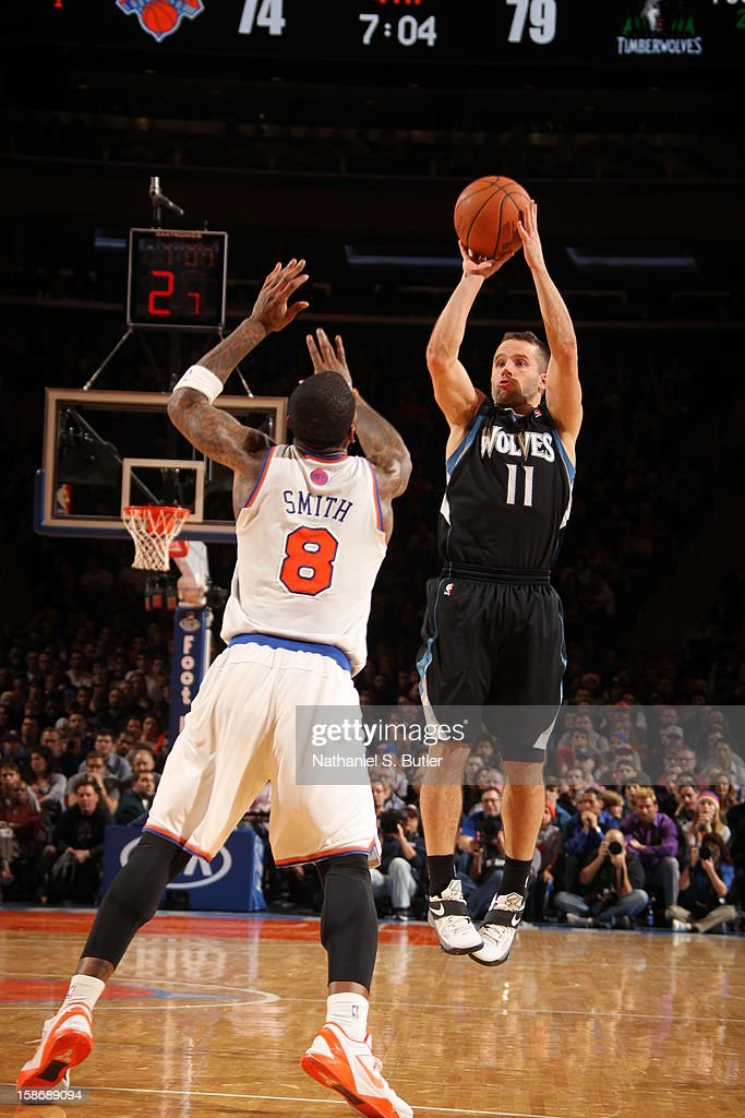 Jose Barea #11 of the Minnesota Timberwolves shoots against J.R. Smith #8 of the New York Knicks on December 23, 2012 at Madison Square Garden in New York City.