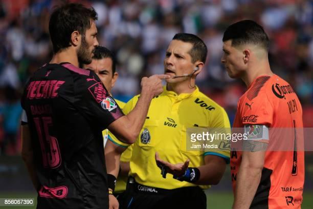 Jose Basanta of Monterrey Diego Montano Robles referee and Tiago Volpi of Queretaro argue during the 12th round match between Queretaro and Monterrey...