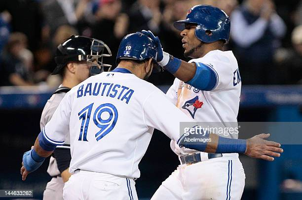 Jose Bautista and Edwin Encarnacion of the Toronto Blue Jays celebrate Encarnacion's threerun home run against the New York Yankees during MLB action...