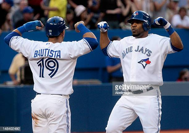 Jose Bautista and Edwin Encarnacion of the Toronto Blue Jays celebrate Encarnacion's tworun home run against the Baltimore Orioles during MLB action...