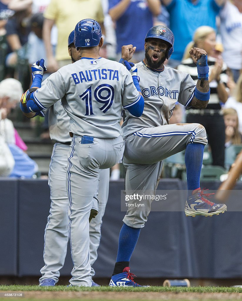 Jose Bautista #19 and Jose Reyes #7 of the Toronto Blue Jays celebrate Bautista's three run homer against the Milwaukee Brewers at Miller Park on August 20, 2014 in Milwaukee, Wisconsin.