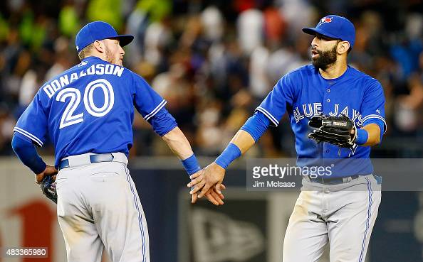 Jose Bautista and Josh Donaldson of the Toronto Blue Jays celebrate after defeating the New York Yankees at Yankee Stadium on August 7 2015 in the...