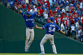 Jose Bautista and Roberto Osuna of the Toronto Blue Jays celebrate the 84 win against the Texas Rangers in game four of the American League Division...