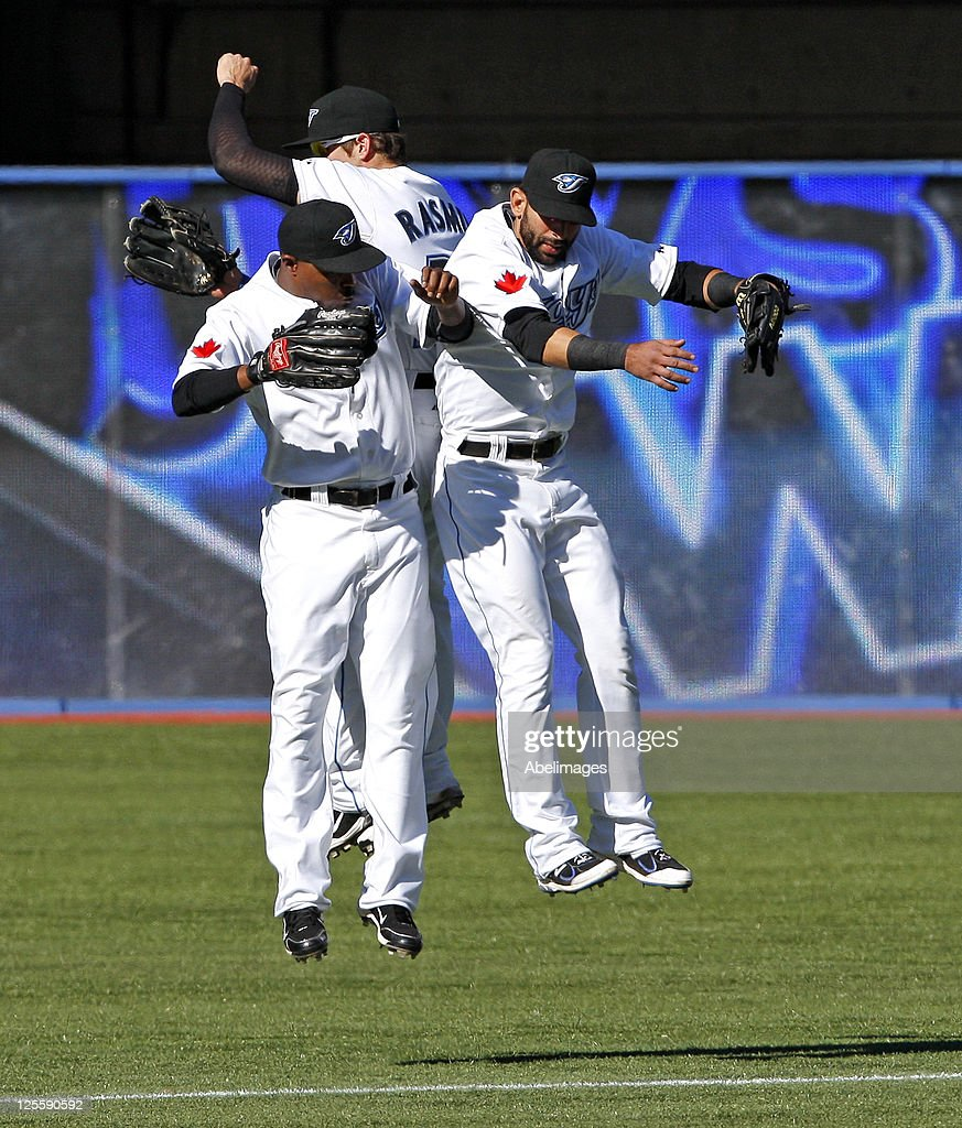 Jose Bautista #19, <a gi-track='captionPersonalityLinkClicked' href=/galleries/search?phrase=Colby+Rasmus&family=editorial&specificpeople=3988372 ng-click='$event.stopPropagation()'>Colby Rasmus</a> #28, and <a gi-track='captionPersonalityLinkClicked' href=/galleries/search?phrase=Dewayne+Wise&family=editorial&specificpeople=704740 ng-click='$event.stopPropagation()'>Dewayne Wise</a> #3 of the Toronto Blue Jays celebrate 3-0 win against the New York Yankees during MLB action at the Rogers Centre September 18, 2011 in Toronto, Ontario, Canada.