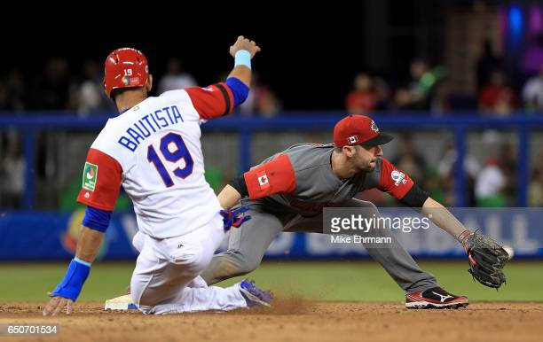 Jose Bautista is forced out at second by Jonathan Malo of Canada during a Pool C game of the 2017 World Baseball Classic at Miami Marlins Stadium on...