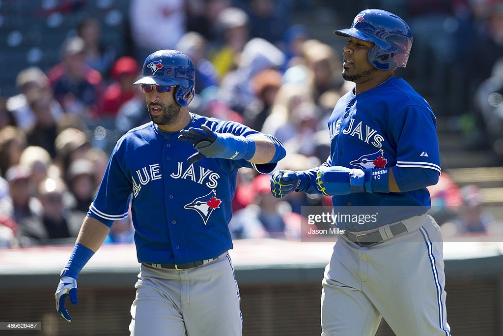 Jose Bautista #19 Jays and Edwin Encarnacion #10 celebrates after scoring on a single by <a gi-track='captionPersonalityLinkClicked' href=/galleries/search?phrase=Dioner+Navarro&family=editorial&specificpeople=593062 ng-click='$event.stopPropagation()'>Dioner Navarro</a> #30 of the Toronto Blue Jays during the seventh inning against the Cleveland Indians at Progressive Field on April 19, 2014 in Cleveland, Ohio.