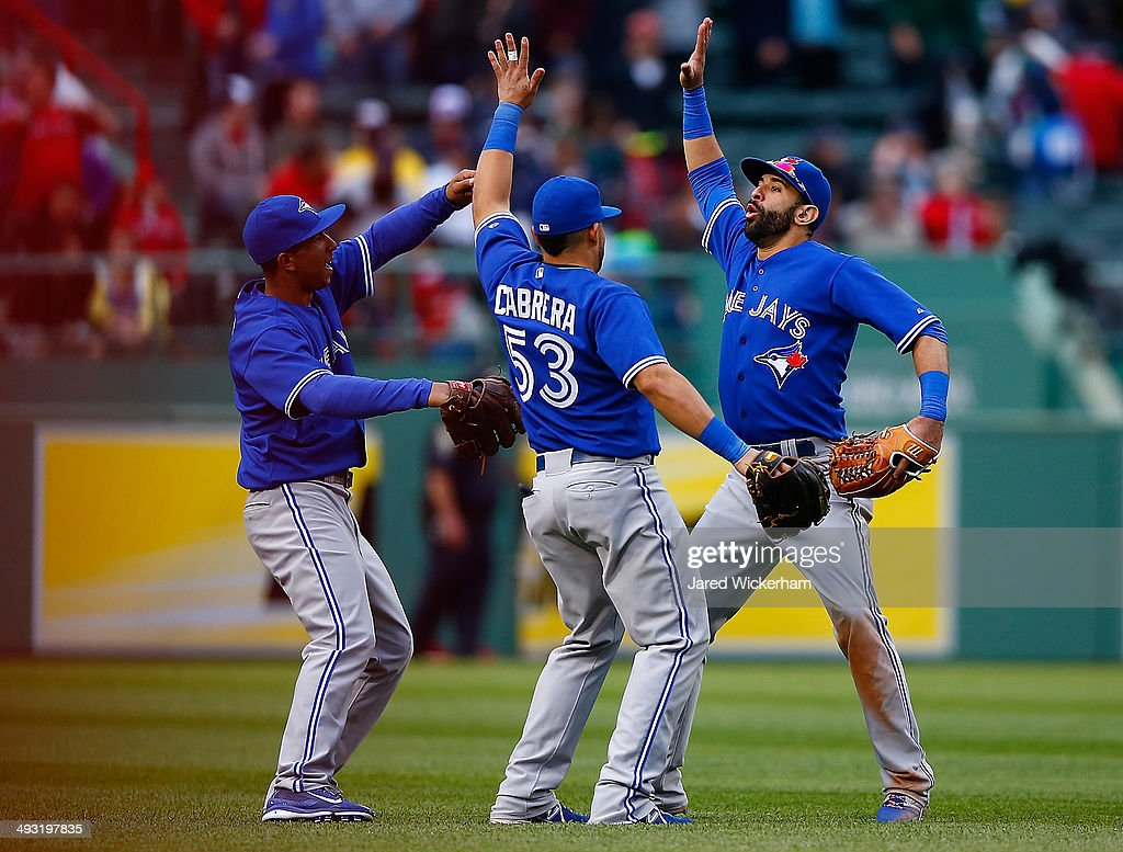 Jose Bautista #19, <a gi-track='captionPersonalityLinkClicked' href=/galleries/search?phrase=Melky+Cabrera&family=editorial&specificpeople=453444 ng-click='$event.stopPropagation()'>Melky Cabrera</a> #53, and <a gi-track='captionPersonalityLinkClicked' href=/galleries/search?phrase=Anthony+Gose&family=editorial&specificpeople=6906091 ng-click='$event.stopPropagation()'>Anthony Gose</a> #8 of the Toronto Blue Jays celebrate their win and sweep of the Boston Red Sox during the game at Fenway Park on May 22, 2014 in Boston, Massachusetts.