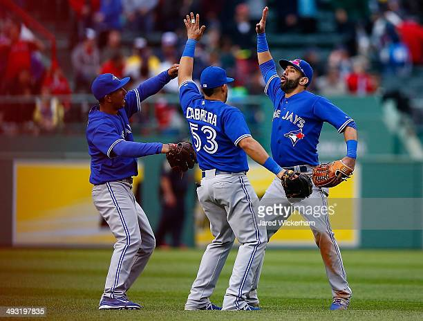 Jose Bautista Melky Cabrera and Anthony Gose of the Toronto Blue Jays celebrate their win and sweep of the Boston Red Sox during the game at Fenway...