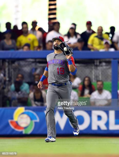 Jose Bautista of Team Dominican Republic catches a fly ball during Game 5 of Pool C of the 2017 World Baseball Classic against Team Colombia on...