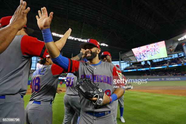 Jose Bautista of Team Dominican Republic celebrates with teammates after defeating Team Colombia 103 in Game 5 of Pool C of the 2017 World Baseball...