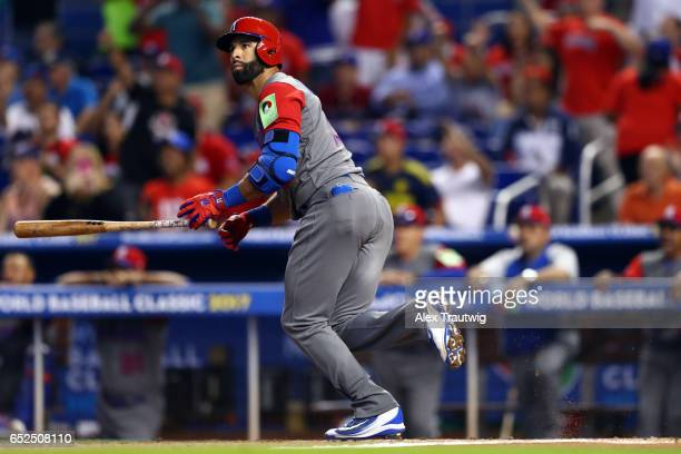 Jose Bautista of Team Dominican Republic hits a sacrifice fly in the first inning during Game 5 of Pool C of the 2017 World Baseball Classic against...