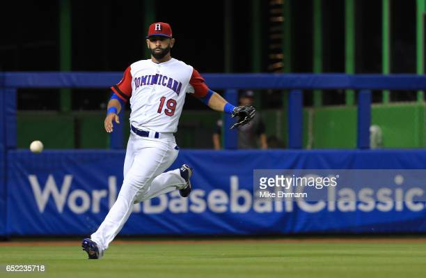 Jose Bautista of the Dominican Republic fields a ball during a Pool C game of the 2017 World Baseball Classic against the United States at Miami...