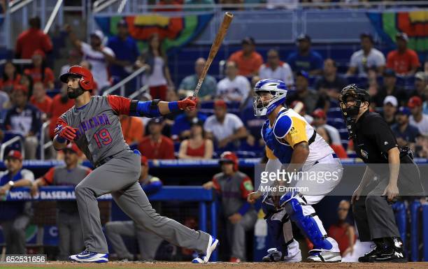 Jose Bautista of the Dominican Republic hits a sacrifice fly scoring a run in the first inning during a Pool C game of the 2017 World Baseball...