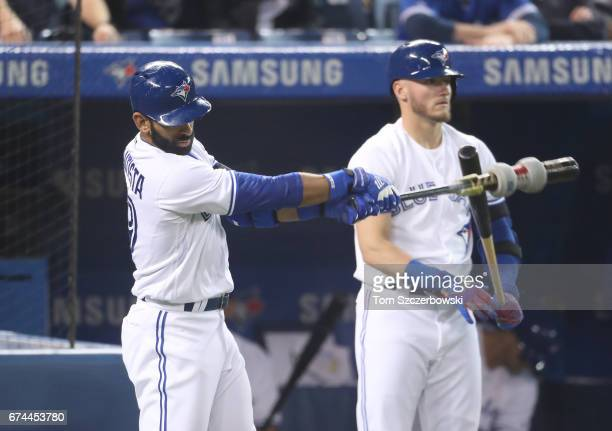 Jose Bautista of the Toronto Blue Jays and Josh Donaldson get ready to bat in the ninth inning from the ondeck circle during MLB game action against...