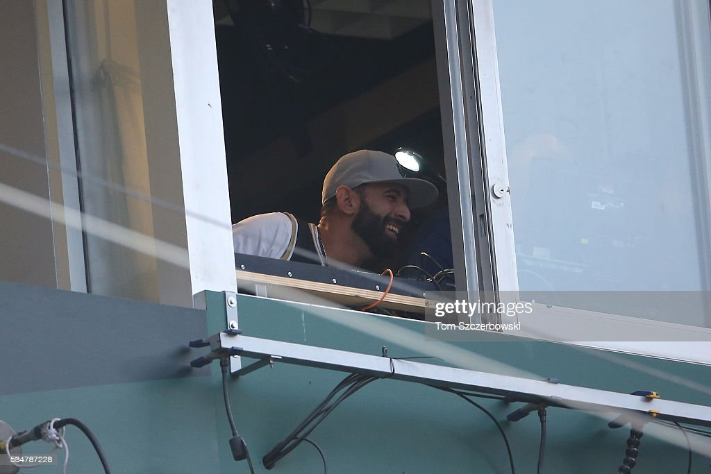 Jose Bautista #19 of the Toronto Blue Jays announces the name of the batter over the public address system as he serves his one-game suspension during MLB game action against the Boston Red Sox on May 27, 2016 at Rogers Centre in Toronto, Ontario, Canada.
