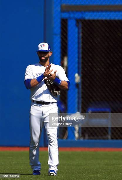 Jose Bautista of the Toronto Blue Jays applauds the crowd prior to the first inning during MLB game action against the New York Yankees at Rogers...