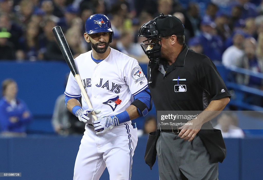Jose Bautista of the Toronto Blue Jays argues with home plate umpire Rob Drake after being called out on a check swing in the fourth inning during...