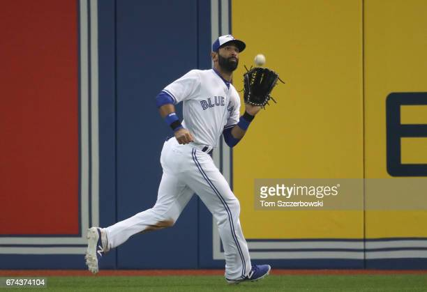 Jose Bautista of the Toronto Blue Jays catches a fly ball in the eighth inning during MLB game action against the Baltimore Orioles at Rogers Centre...