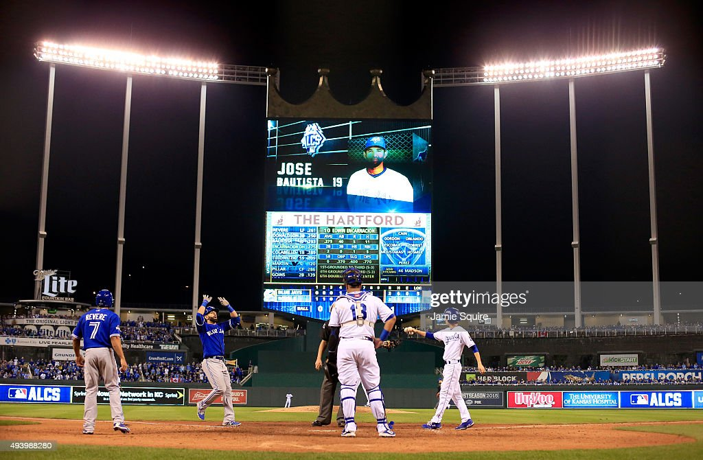 Jose Bautista of the Toronto Blue Jays celebrates after he hits a tworun home run in the eighth inning against the Kansas City Royals in game six of...