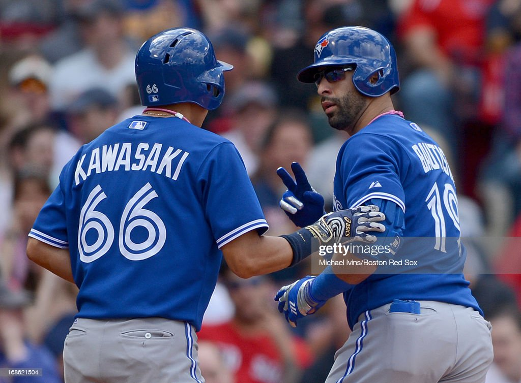 Jose Bautista #19 of the Toronto Blue Jays celebrates after his second home run of the game against the Boston Red Sox with Munenori Kawasaki #66 in the sixth inning on May 12, 2013 at Fenway Park in Boston, Massachusetts.