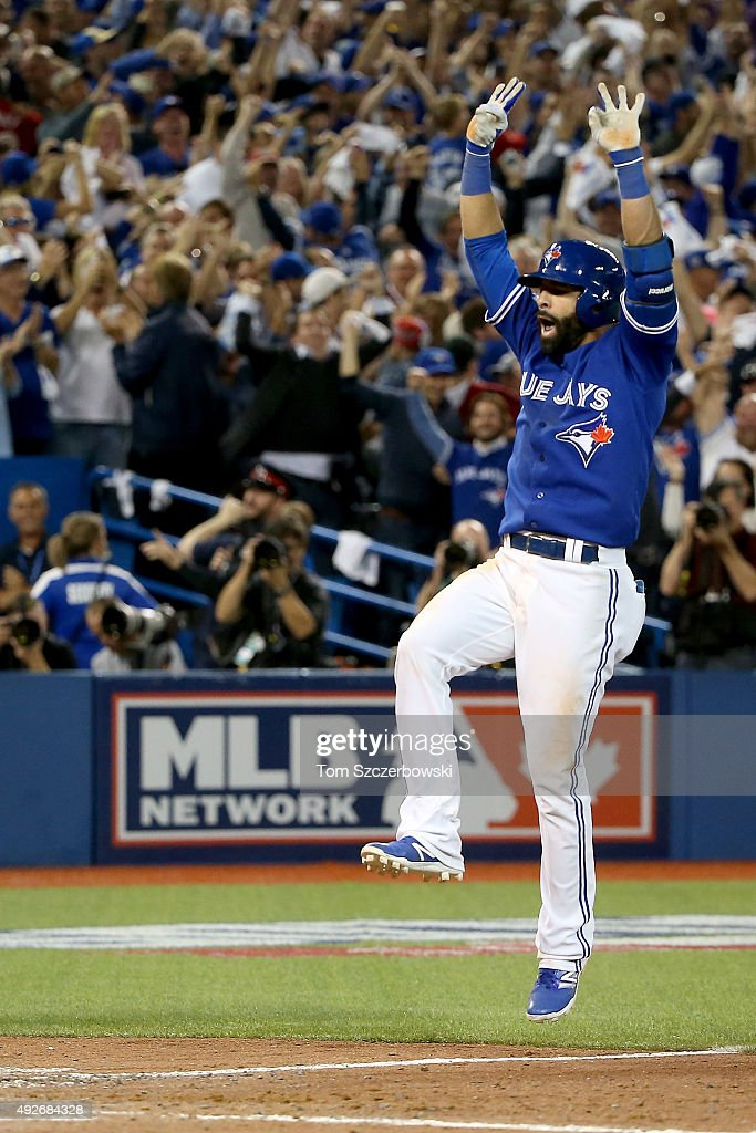 Jose Bautista of the Toronto Blue Jays celebrates as he touches home after he hits a threerun home run in the seventh inning against the Texas...